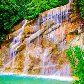 Tembok Barak Waterfall: The Waterfall Behind Sturdy Red Cliffs