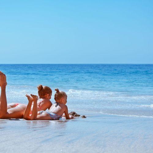 Sunbathing Accompanied by the Waves on the Jerman Beach