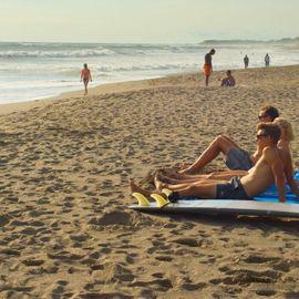 Relaxing and Sunbathing At Canggu Beach